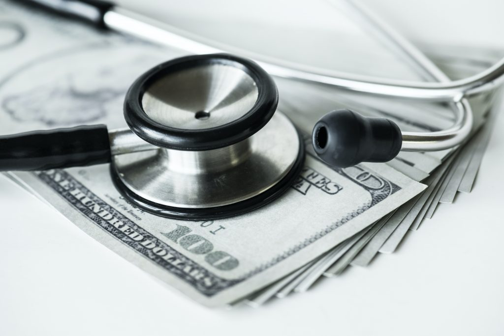 closeup of cash and stethoscope, healthcare revenue cycle management