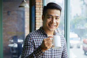 man taking a break at work to get a cup of coffee, corporate wellness
