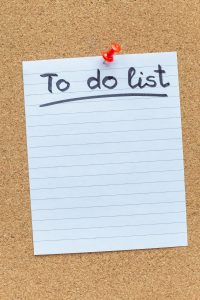 cork board with To Do list posted, corporate wellness