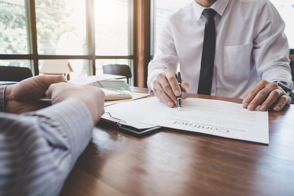 Business Signing a Contract Buy - sell medical practice