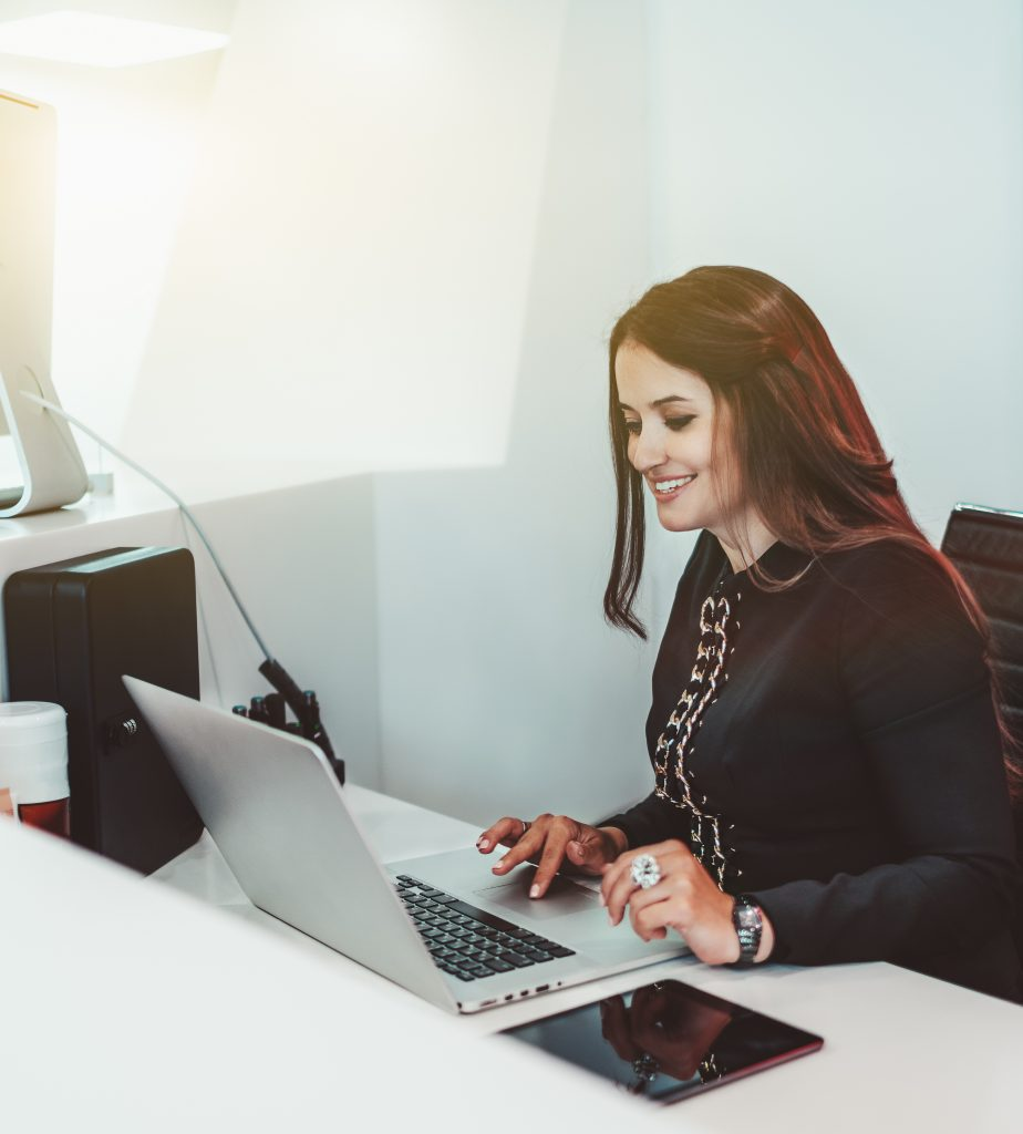 Woman receptionist with a laptop, patient satisfaction