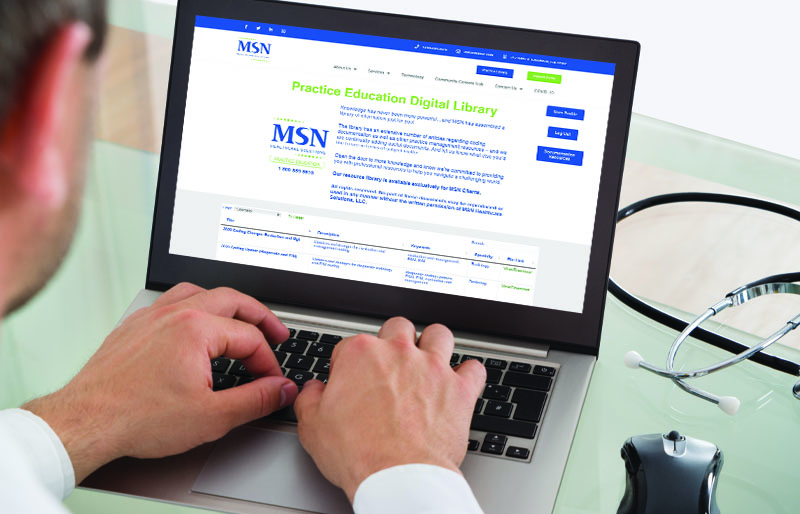 doctor looking at MSN practice library on computer