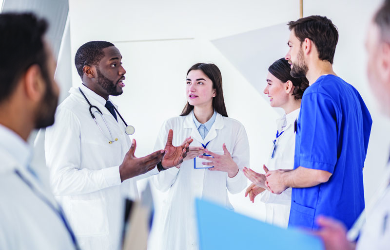 group of doctors talking about quality payment options