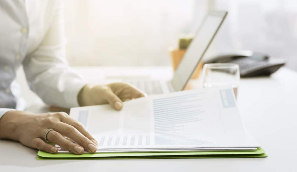 Businesswoman checking MIPS reports and statements